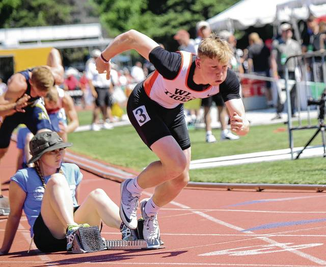 West Liberty-Salem's Raiph LeVan (pictured) exhales sharply as he breaks away from his blocks on Friday during the 400 preliminaries at the Division III state track and field championships in Columbus. LeVan finished second in his heat and automatically qualified for Saturday's finals.
