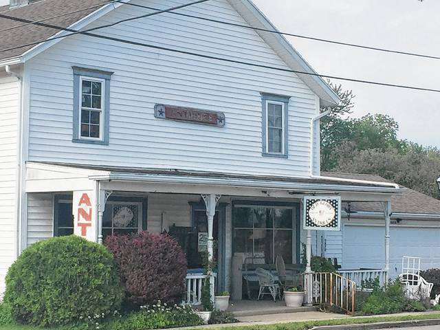 """Old Glory Antiques in the small town of Mutual is one of the places you can find by going off the beaten path and driving the road less traveled in search of antigues can yield best """"finds & treasures."""""""