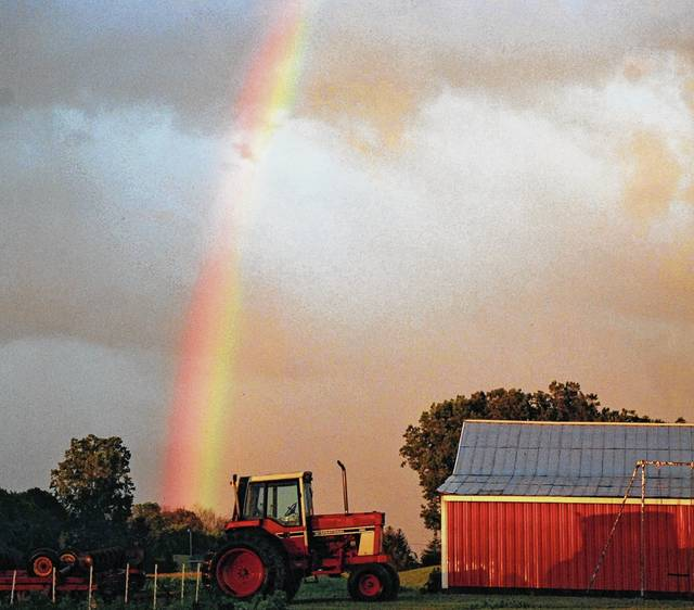 A rainbow appears to launch into the sky from Oak View Farm Meats on state Route 54 just before the sun set on Sunday evening. A storm front moved through the area and cleared the horizon just in time for the sun to put on a display against the raindrops in the eastern sky. Temperatures are expected to remain cooler for the next 10 days after the area endured high heat levels last week and over the weekend.