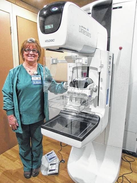 Peggy Gentis, Registered Mammography Technician, is one of a few technicians who travel with Community Mercy Health Partners' Mobile Mammography vehicle to Mercy Memorial Hospital and other locations in Champaign County. She is shown here beside a mammography screening unit inside the vehicle, which visits MMH Tuesday through Thursdays.