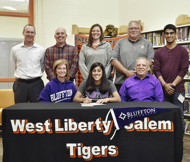 West Liberty-Salem's Lily Yoder recently signed her letter of intent to play basketball at Blufton University this year. Lily is pictured with her parents, Brian and Sherrie Yoder, and her brother Nik (back row, right), along with her coaches Aaron Hollar, Andy Cotrell, Melissa Louden, and Dennis McIntosh.