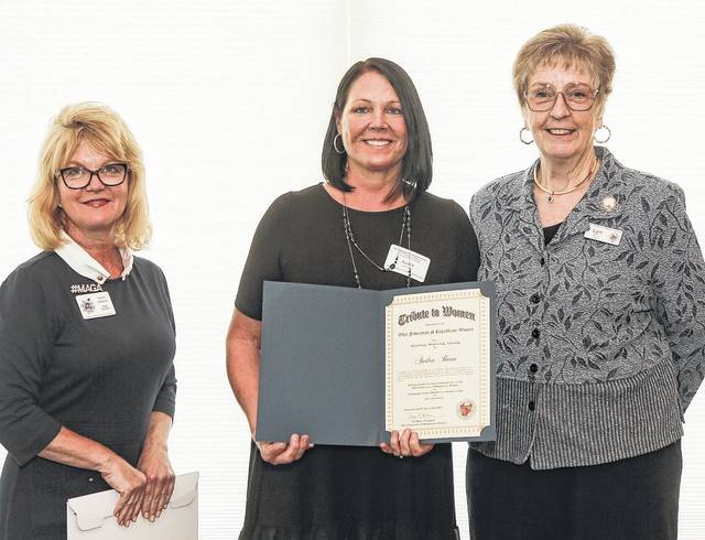 Recipient of the OFRW's Tribute to Women, Audra Bean, middle, is shown with NFRW President Carrie Almond, left, and OFRW President Lyn Bliss, right.