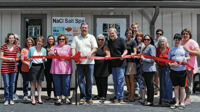 The Champaign County Chamber of Commerce celebrated the grand opening of NaCl Salt Spa, 646 Bodey Circle, with a ribbon-cutting June 19. From left are Lori Wallace, Susan O'Bryant, Kim Chevalley, Chamber Director Lydia Hess, Hannah Tukesbrey Kilbride, owners Sharon and Brad Wallace, Eva Carey, Pat Thackery, Tina Jones, Pete Doss, Tammy Ansley, Destinee Bilotta, Linda Locke, Patsy Thackery, Kenny Stewart and Holly Stewart.