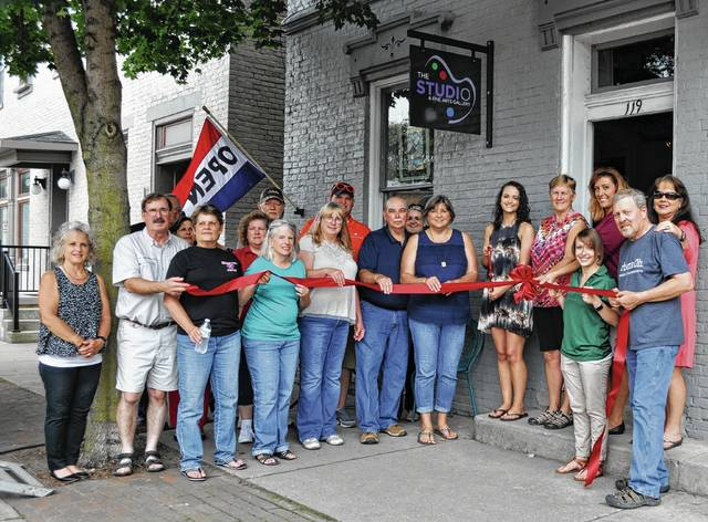 The Champaign County Chamber hosted a ribbon-cutting to welcome The Studio & Fine Arts Gallery, 119 Scioto St., to downtown Urbana on June 22. From left are Vicki Deere-Bunnell, Dave Millner, Jerry Osborne, Jenny White, Pam Bolton, Sharon Wallace, Steve Dorsey, owner Patsy Thackery, Kelly Jetter, Ryan Berry, Dan McBride, Heather Martin, Debbie Loffing, Lily Jones, Kay Nutter, Chamber Director Lydia Hess, Kelly Rose, owner Pat Thackery, and Kay Falkner-McOwen.