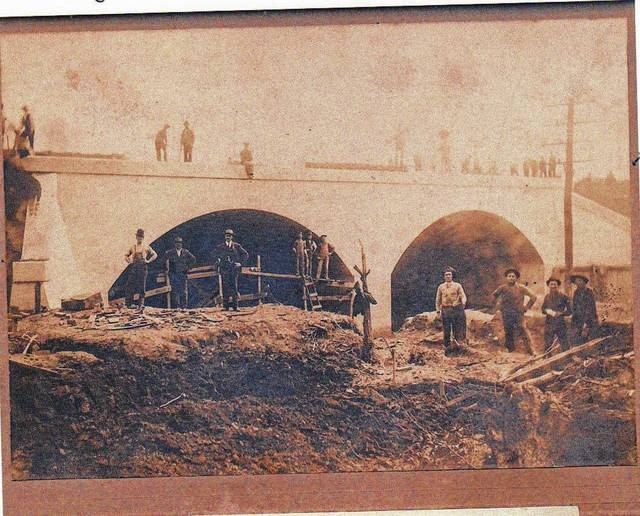 Then: This photo was taken during construction of the Pennsylvania Railroad arch bridge over Nettle Creek, circa 1900.