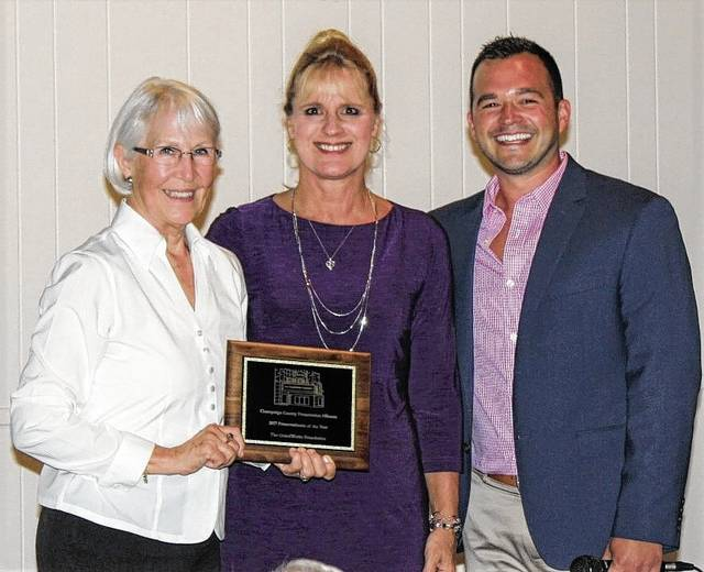 Mary Mott presents Preservationist of the Year Award to GrandWorks Chairman Staci Weller, CCPA President Dusty Hurst assists.