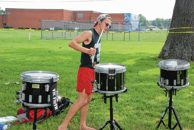 Sam Hill, drumline instructor for the Madison High School band, warms up on the drums during a recent band camp at Urbana University. The university hosts such camps throughout the summer until students return to campus.