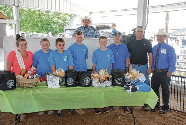 Cole Pond, Grand Champion Overall Production, sold a cheese and butter basket to a syndicate of buyers for $860.