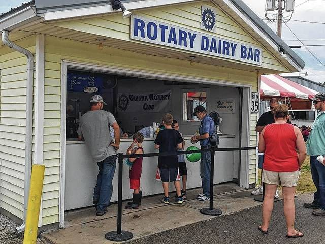 Visitors to the Champaign County Fair line up for ice cream treats at the Urbana Rotary Club's Dairy Bar.