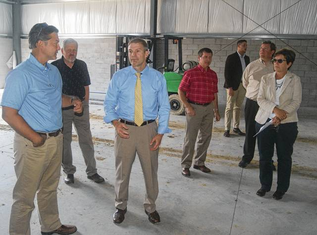 Inside Navistar's new warehouse at the Urbana Industrial Park, U.S. Rep. Jim Jordan, third from left, speaks with Brad Damewood of Damewood Enterprises, which is leasing the property to Navistar. Also pictured are Pat Thackery, an Urbana city councilman and board member of the Champaign Economic Partnership; Steve Hess, Champaign County commissioner and CEP board member; Kirby Brandenburg (background), U.S. Rep. Jim Jordan's field representative; Kyle Hall, CEP board member; and CEP Director Marcia Bailey.