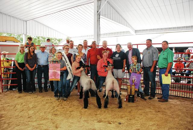 Hanna DeLong's Champion Market Lamb and Reserve Champion Market Lamb sold for $2,675 to a syndicate of buyers.