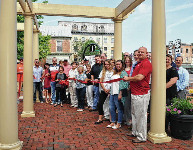 The Champaign County Chamber hosted a 9:30 a.m. ribbon cutting on Friday, July 14, 2017 to celebrate the Monument Square District's Legacy Park. Pictured left to right: Ryan Berry, Jeremiah Stocksdale, Cathy Brennan Maus, Brett Spriggs, Diane Kremer, Chamber Director Lydia Hess, Jim White, Judy Page, MSD President Marcia Bailey, Eileen Grogan, Rob Pollock, Audrey Ferryman, Vicki Deere-Bunnell, , Joe Buckalew, Karen Cook, Adam Moore, Dennis Turner, Sarah Thornton, Hannah Tukesbrey Kilbride, Paul Waldsmith, Kara Stephens, Tim Bunnell, Dwight Paul, Chris Leapley, Brittany Lewis and Chris Moell.