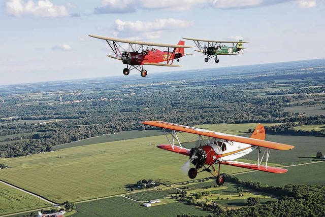The 2017 Mid-Eastern Regional Fly-in (MERFI) to be held this weekend at Grimes Field in Urbana will feature a Barnstorming Festival, similar to the annual Barnstorming Carnival held in Springfield. Pictured during a past Barnstorming Carnival, which is organized by Dewey Davenport, are three biplanes flying over farmland between Springfield and Yellow Springs. Davenport is helping organize the festival in Urbana and will be offering biplane rides to the public.