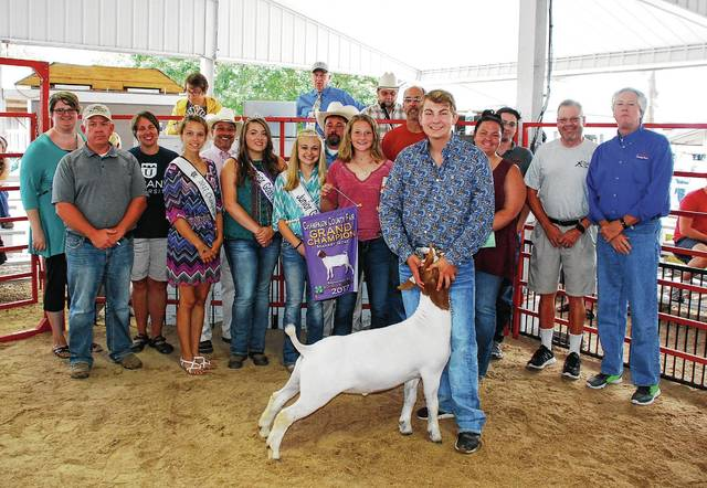 Nathan Violet sold his Champion Market Goat for $950 to a syndicate of buyers.