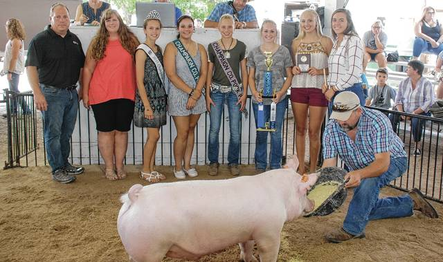 Tory Cordell's Champion Lean Gain Barrow sold for $275 to Clayton Tire.