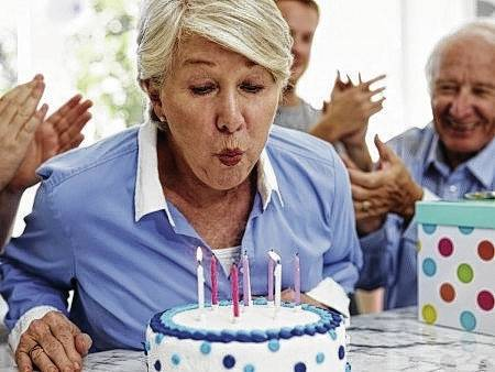 Although bacteria is transmitted from blowing mouths to the birthday cake, that doesn't mean cake eaters will get sick.