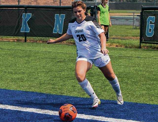 Urbana's Alyssa Garberich puts the ball back into play on Tuesday against Notre Dame College. The Blue Knights fell, 2-1, to their MEC rivals.