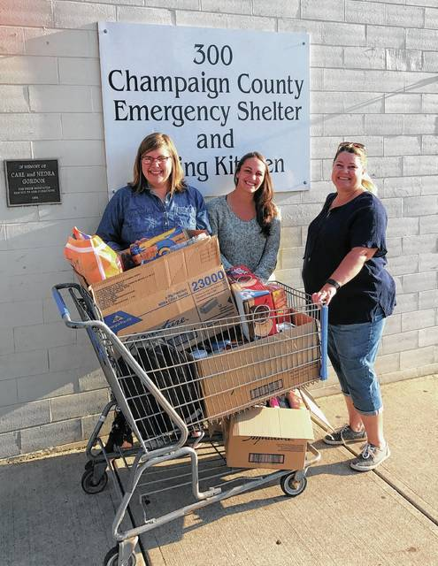 CT Communications employees and customers collected approximately 120 pounds for child-friendly food for the Caring Kitchen's Backpack Program. Pictured are CT employees Emily Huffman and Vana Beekman delivering the donations to the Caring Kitchen Assistant Director Tara Jordan.