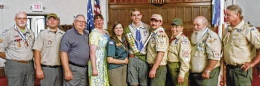 Eagle Scout Mikey Meyer is pictured with participants in his Court of Honor and family. From left, are Tecumseh Council representative Bob Hemmerly, Troop 11 Scoutmaster, Tony Brown, Allan and Anne Baker, Janice Baker Meyer, Meyer, Mike Meyer, Sheila and Robert Meyer, David Greenlee, former Troop 11 Scoutmaster and Committee Chairman.