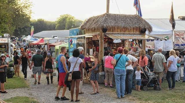 Visitors check out the offerings of food vendors at a previous Fish & Shrimp Festival.