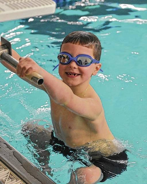 YMCA member Grayden Edwards, age 7, competes in a 25-meter backstroke race this past winter.