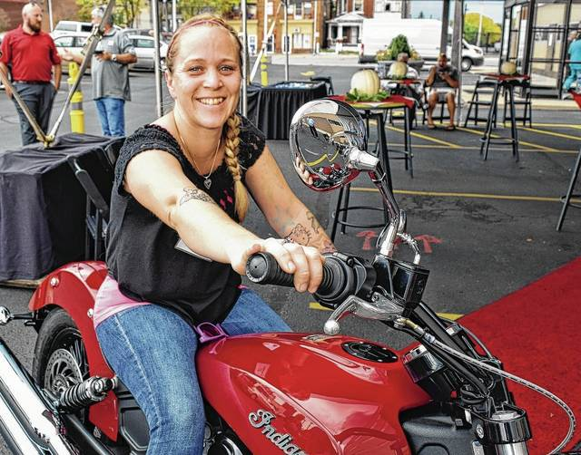 Urbana donor Judie Dillon wins the grand prize Indian Scout Sixty motorcycle in the Community Blood Center's Scouting for Donors Summer Blood Drive.