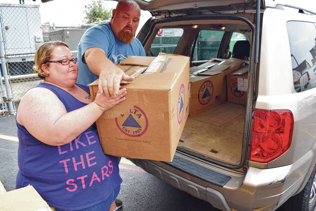 James and Teesha McConnahea do their part to help the recent hurricane victims.