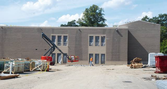 As these two photos show, construction is progressing on the new Urbana High School. The building is being constructed at the Washington Avenue campus and is designed to complement the iconic Castle Building, which will remain intact on the site.