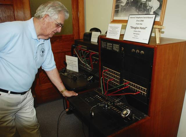 Joe Rizzuti checks out the Douglas Hotel internal telephone switchboard (circa 1940), which is on display at the Champaign County Historical Society museum, 809 East Lawn Avenue. The CCHS will host Oktoberfest at the museum from 10 a.m. to 4 p.m. Sunday, Oct. 1.