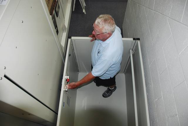 Dick Virts tries out the new elevator at the Champaign County Historical Society museum, 809 East Lawn Ave. The elevator was obtained through a Community Development Block Grant. Virts said the Champaign County commissioners along with Dave Gulden of the Logan-Union-Champaign Regional Planning Commission were instrumental in obtaining the grant. The CCHS will host Oktoberfest at the museum 10 a.m.-4 p.m. Sunday, Oct. 1. The festival is the key fundraiser for the historical society.