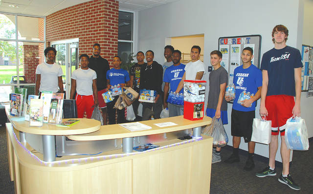 Members of the Urbana University Blue Knights basketball team assisted the Student Athletic Advisory Council in collecting donations for Hurricane Maria victims in Puerto Rico, in collaboration with the Alicia Titus Memorial Peace Fund. Donations were collected Oct. 16-20 at the university Student Center, Champaign County Library and the county Chamber of Commerce.