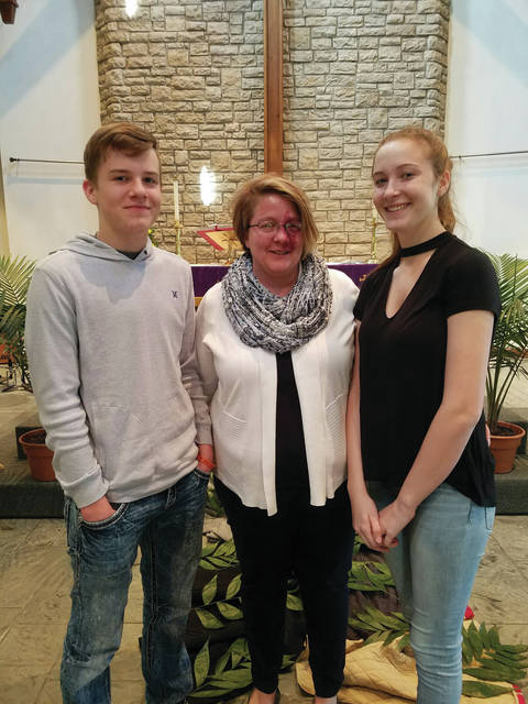 Melanie Blankenship and her children Braden and Macey will receive the keys to a new house in St. Paris on Oct. 28.
