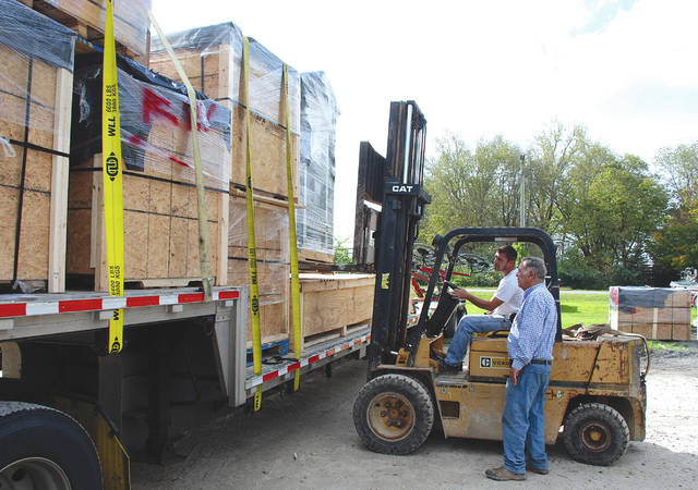 Fred Channell, owner of Channell Equipment, assists his forklift driver, Shon Ballard, on Oct. 13, in loading a SolarCool ColdShed onto a truck bound for victims of Hurricane Maria in Puerto Rico. The truck loaded with 20 generators, lots of water, flashlights and batteries will head to Jacksonville, Florida, where it will be loaded onto a ship bound for San Juan, Puerto Rico, where Channell's business partner Pedro Torrado will receive it.