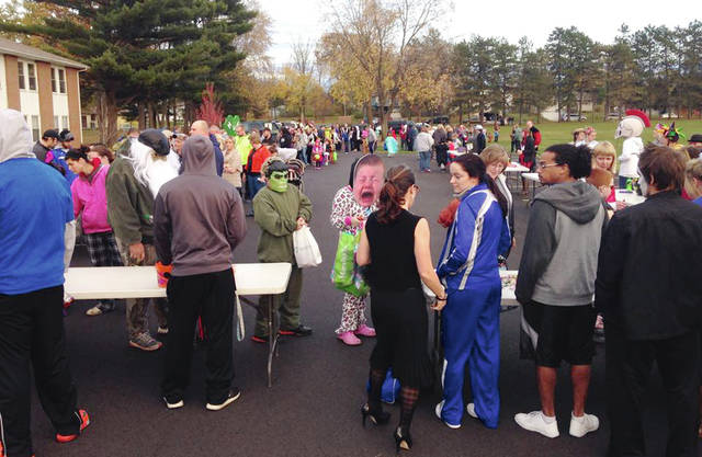 Urbana University hosts trick-or-treaters each year during the city's version of Urbana's Beggars Night. Pictured is a previous event along High Street, but this year's event will be held on the lawn near the Student Center.