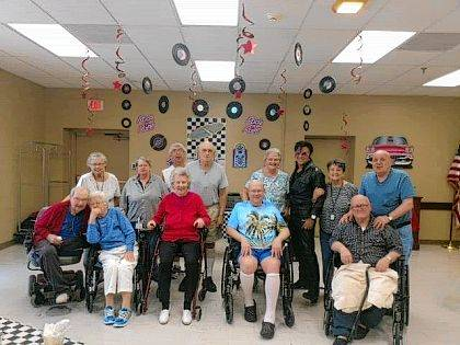 """Vancrest of Urbana Assisted Living residents celebrate with Mason Riley (""""Elvis"""")."""