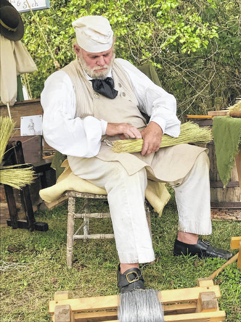 Fritz Kannik, of Springfield, demonstrates how to make a broom at the primitive encampment during the Christiansburg bicentennial.