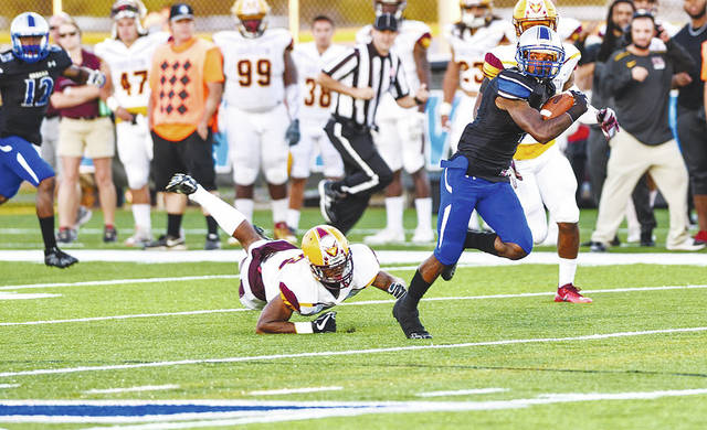 UU's Trevon Saunders eludes a tackler during a recent game. The Blue Knights host Glenville State on Saturday.