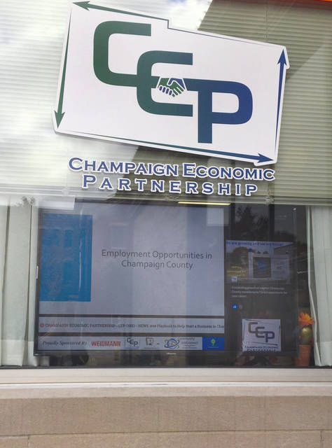 A new electronic display monitor is in the window of the Champaign Economic Partnership on Monument Square.