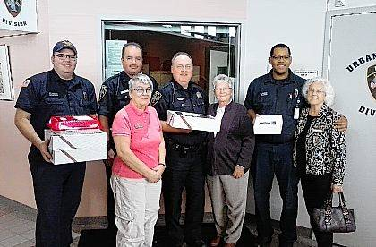 Six groups of DAR members delivered homemade baked goods to first responders all over Champaign County for our Service to America project. Pictured in one of these groups are members Carol Tong, Lana Seeberg and Judi Henson with Urbana police and firemen.