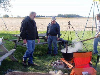 Operation Rebirth volunteers make apple butter in a kettle during the recent Day on the Farm open house.
