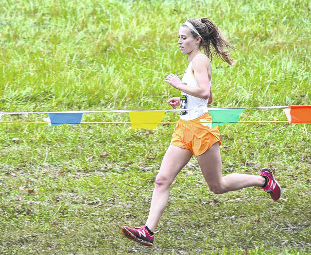 West Liberty-Salem's Reghan Bieleski strides toward the final straightaway at National Trail Raceway on Saturday at the state cross country championships. Bieleski finished in the top 20 to earn a medal in her fourth state appearance.