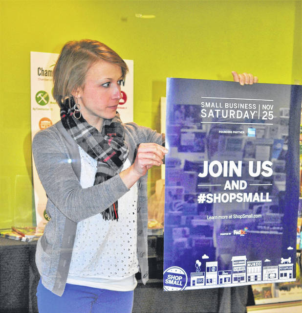 Chamber Executive Director Lydia Hess shows a promotional piece for Small Business Saturday.