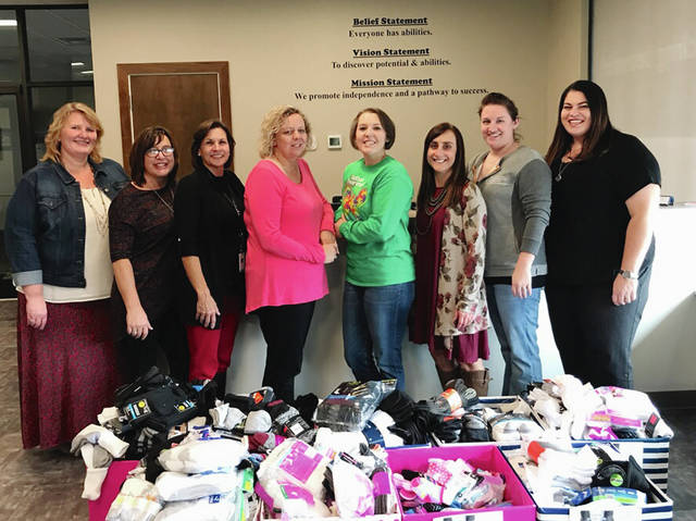 Pictured from left are Heather Williams-Rarey, Rachel Theodor, Jenny White, Mary Kay Snyder, Jess Farmer, Sharon Wheeland, Erica Maze, Jennifer Bradford. All are employees of the Champaign County Board of Developmental Disabilities.