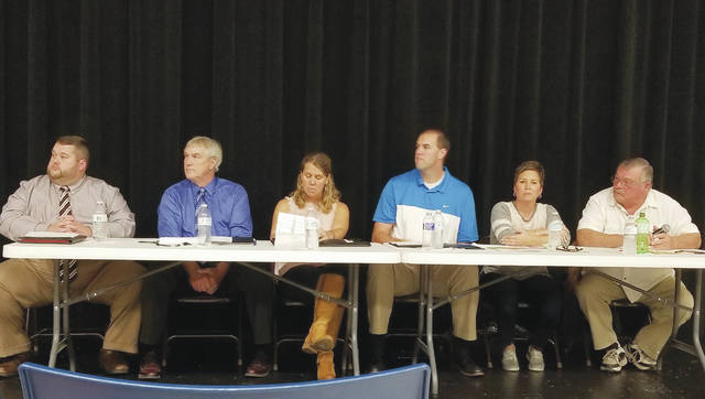 Six candidates running for three seats on the West Liberty-Salem school board participated in a Meet the Candidates forum Thursday. The candidates, from left, include Tim Lamb, David S. Cline, write-in candidate Julie Cole, Trey Richardson, Dixie Kopus and current board member Chuck Buck.