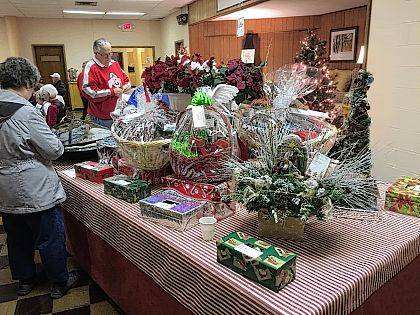 Melanie and Ron Deere look over items to be raffled at the Home Made Christmas Bazaar.