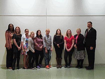 From left are Principal Cheryl Carter, Zoey Cahall, Kendra Baccus, Kourtney Hilliard, Marah Kerns, Wyatt Pelfrey, Grace Slagle, Justice Magann, McKenzie Lamb, school counselor, and Superintendent Thiel.