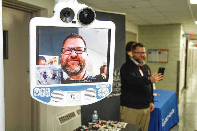 John Wooten, OSU Telestroke Program, shows how technology enables Mercy Health – Urbana Hospital to communicate with Ohio State University during a stroke event. Wooton was illustrating how a doctor would be seen on the monitor.