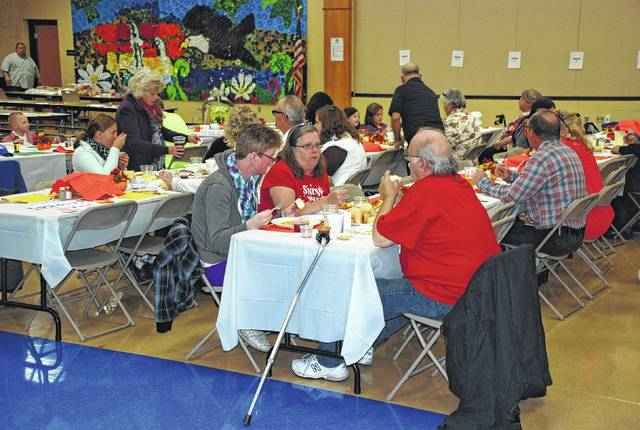 St. Paris-area churches will host a community Thanksgiving at Graham Elementary School. The event is one of two large Thankgiving dinner efforts, the other being in Urbana at the Caring Kitchen. In photo, community members gather for a previous dinner in 2015 at Graham.