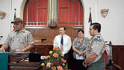 Troop 11 Scoutmaster Tony Brown gives the Eagle Charge to Eagle Scout Nickolas Pettit, as his parents, Robert and Holly Pettit, watch the ceremony.