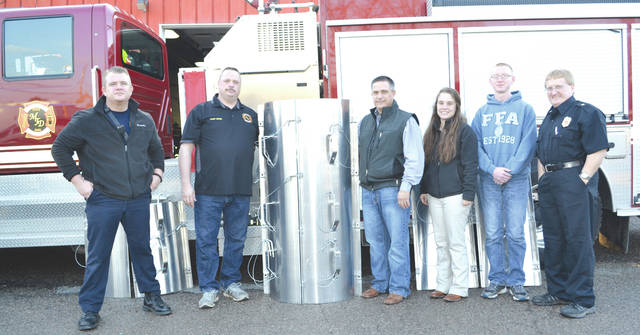 The Mechanicsburg Fire Department on Thursday accepted a $2,000 coffer dam that can be used to rescue a person trapped in a grain bin. It was donated through a joint effort of Heritage Cooperative and the Mechanicsburg High School agriculture program. Pictured from left are Mechanisburg Firefighter Jim Aills, Fire Chief Bob Keene, agriculture teacher Kevin Neer, agriculture teacher Deon Morter, FFA senior John Kent and Assistant Fire Chief Steve Castle.